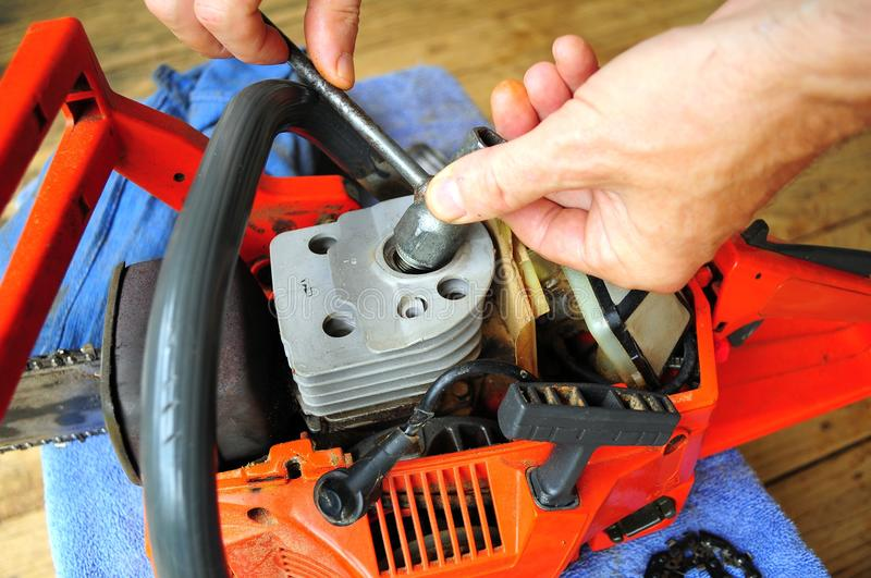 Replacing Spark Plug, Chainsaw Maintenance. Doing yearly tune-up routine on a Chainsaw royalty free stock photo