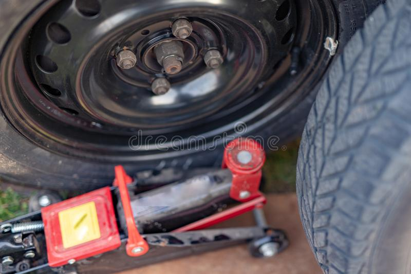 Replacing the wheel in a passenger car. Changing wheels from winter to summer. Season of the spring royalty free stock photography