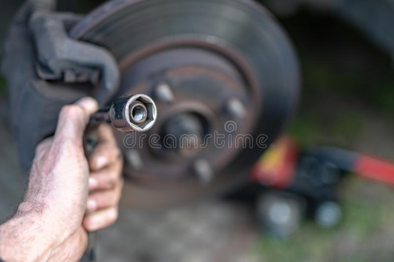 Replacing the wheel in a passenger car. Changing wheels from winter to summer. Season of the spring royalty free stock photos