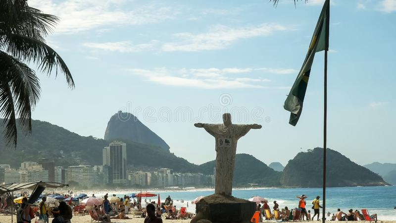 Christ statue replica on copacabana beach in rio de janeiro, brazil royalty free stock photos