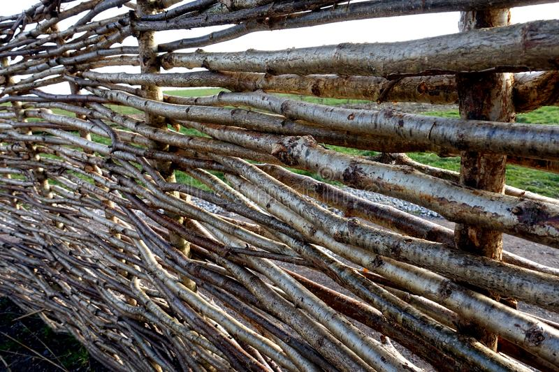 Twig Fence. A replica of a Neolithic twig fence reconstructed at the Stonehenge Visitor Center near the Stonehenge monument in England, depicting how ancient stock photography