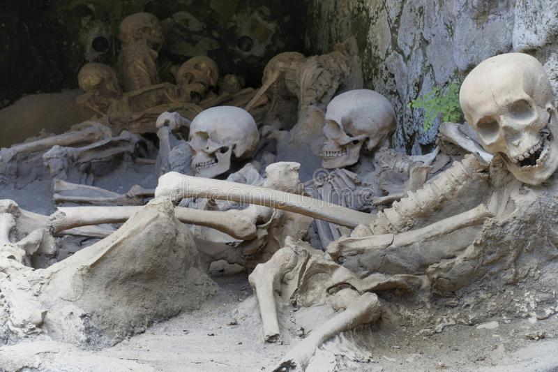 Replica skeletons in the position that the bodies were found after volcanic flow in 79AD Herculaneum. Ercolana Campania Italy stock image