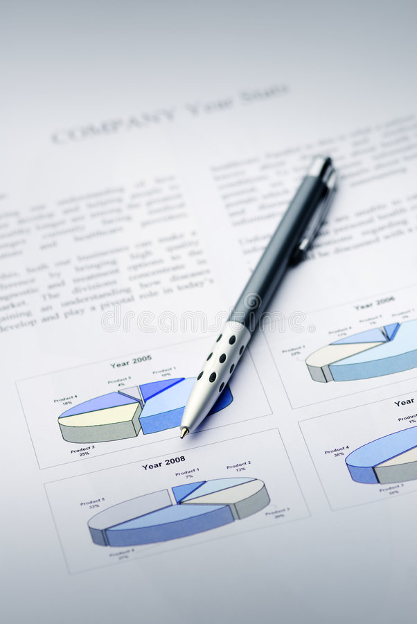 The Report. Company year report with graphs and pencil royalty free stock images