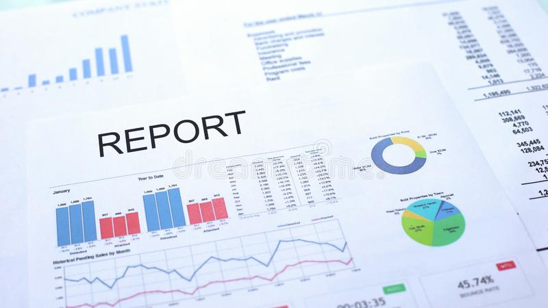 Report lying on table, graphs charts and diagrams, official document, statistics royalty free stock image