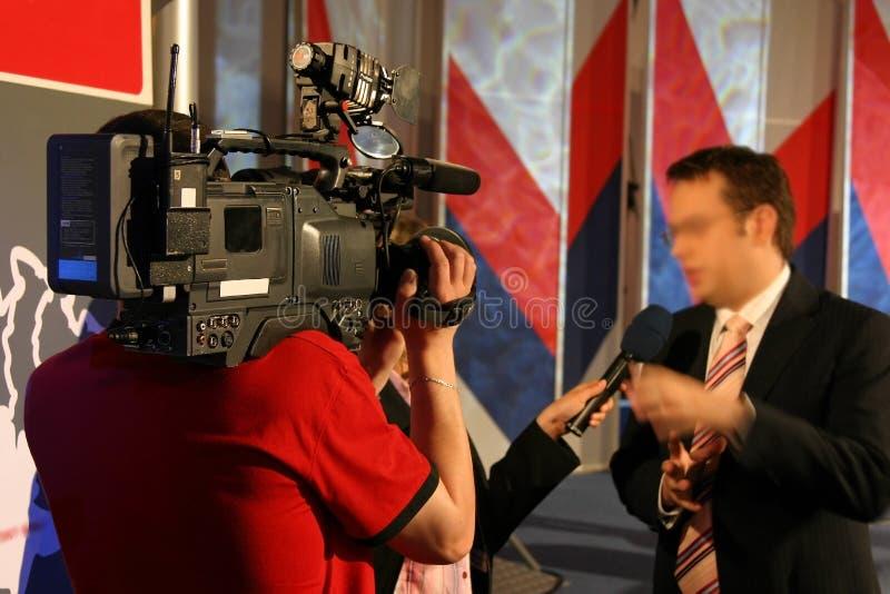 Reportage della TV con il commentatore fotografia stock