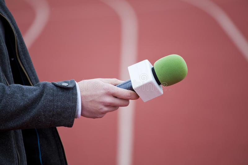 Download Reporter Holding Microphone Stock Image - Image: 34693449