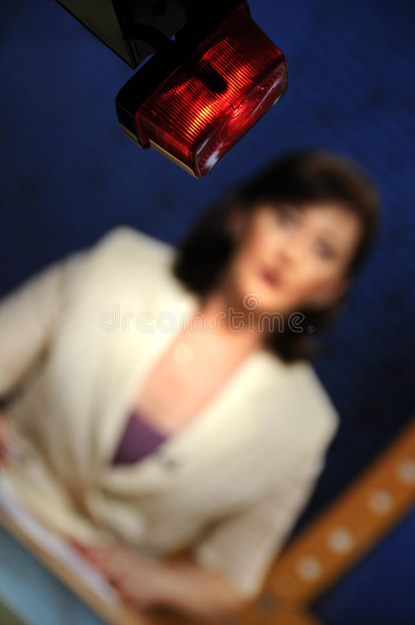 Reporter presenting news in TV studio. On the air sign royalty free stock photo
