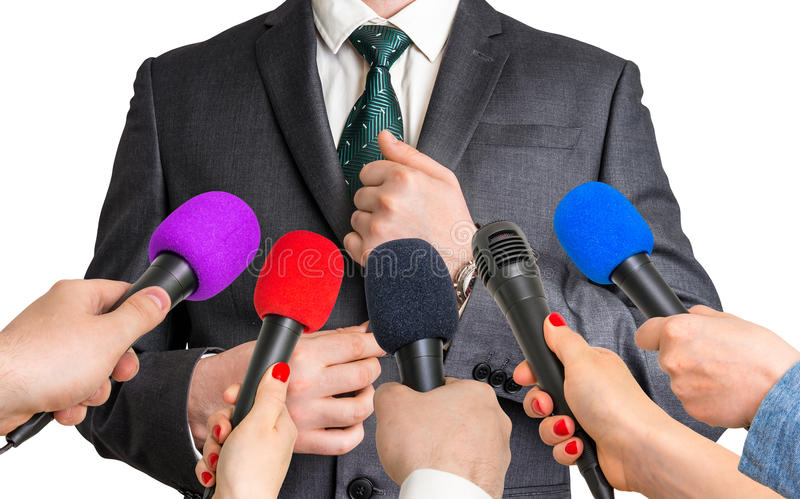 Reporters making interview with businessman royalty free stock photos