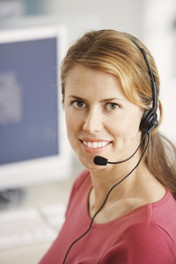 Représentant de sourire de service client image stock