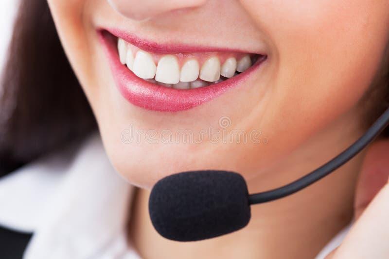 Représentant de sourire de service client images stock