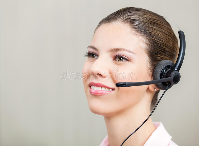 Représentant Wearing Headphones de service client photo libre de droits