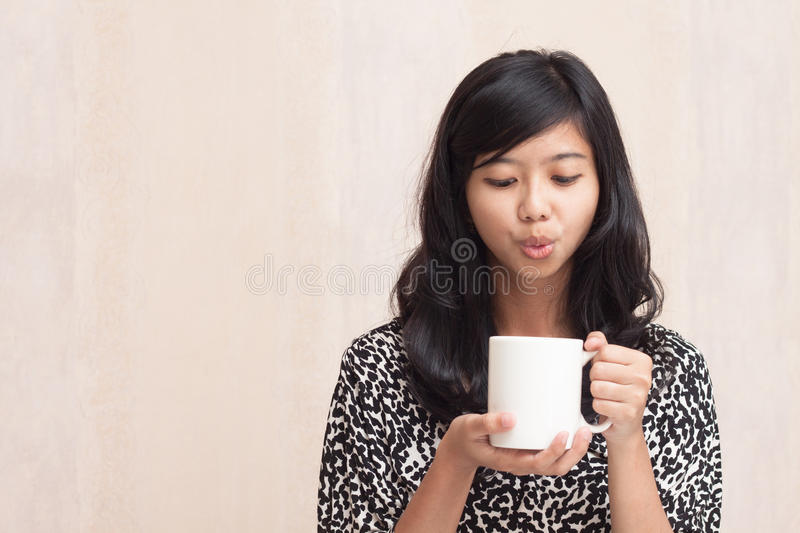 Download Beautiful Asian Girl Blowing A Hot Beverage Stock Photo - Image: 30008544