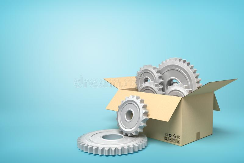 representación 3d de las ruedas dentadas grises del metal en caja del cartón en fondo azul imagen de archivo libre de regalías