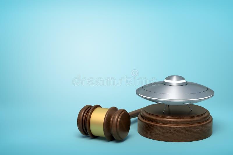 representación 3d del UFO del metal plateado en bloque de madera redondo y el mazo de madera marrón en fondo azul fotografía de archivo libre de regalías