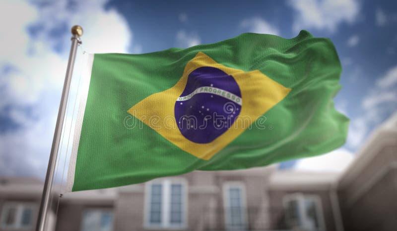 Representación de la bandera 3D del Brasil en fondo del edificio del cielo azul imagenes de archivo