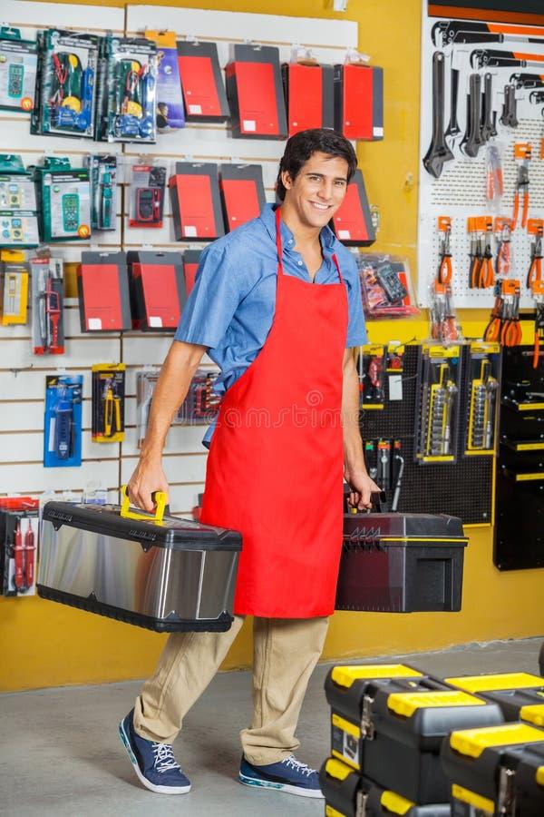 Representant Carrying Toolboxes While som går i lager arkivbilder