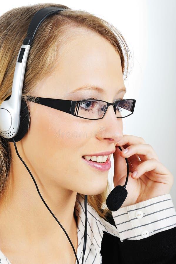 Representante amigável do cliente com auriculares fotografia de stock royalty free