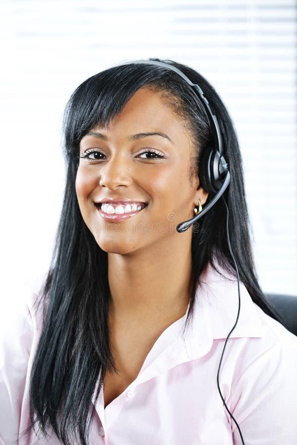Representante del servicio de atención al cliente con el receptor de cabeza fotos de archivo libres de regalías