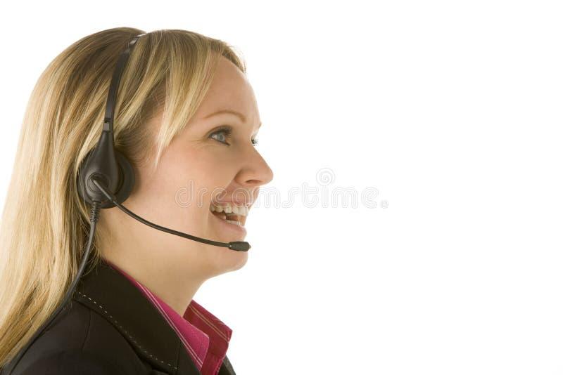 Representante del servicio de atención al cliente con el receptor de cabeza fotografía de archivo libre de regalías