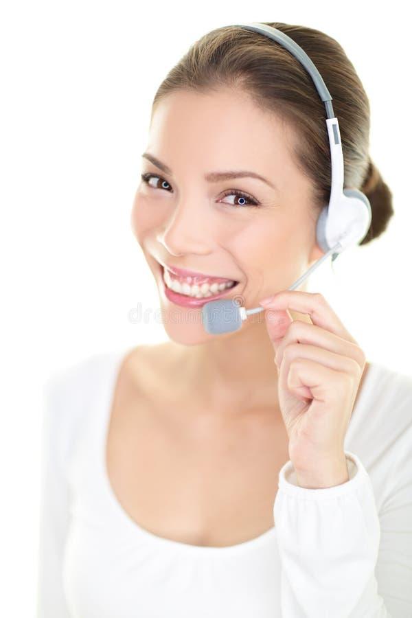 Representante/delegado de servicio de atención al cliente de la mujer de las auriculares del centro de atención telefónica fotos de archivo