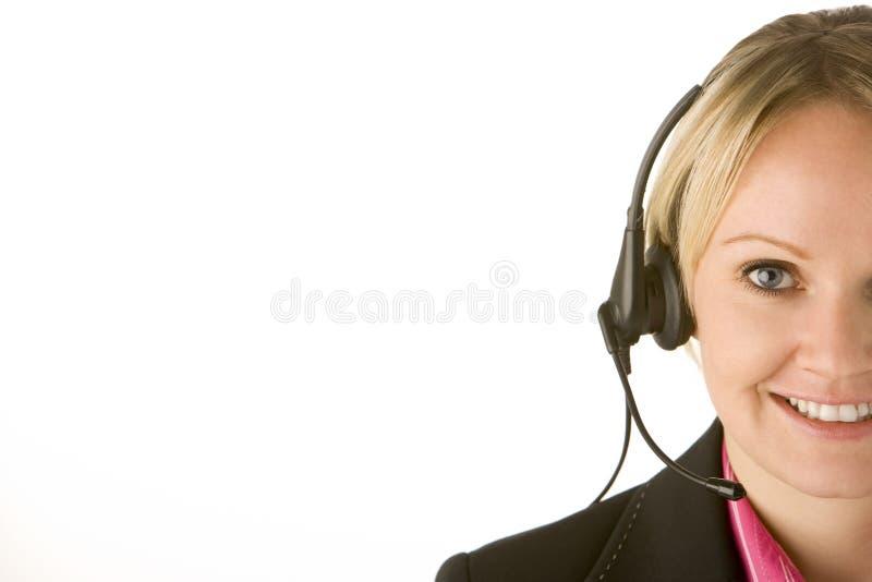 Representante do serviço de atenção a o cliente com auriculares foto de stock royalty free