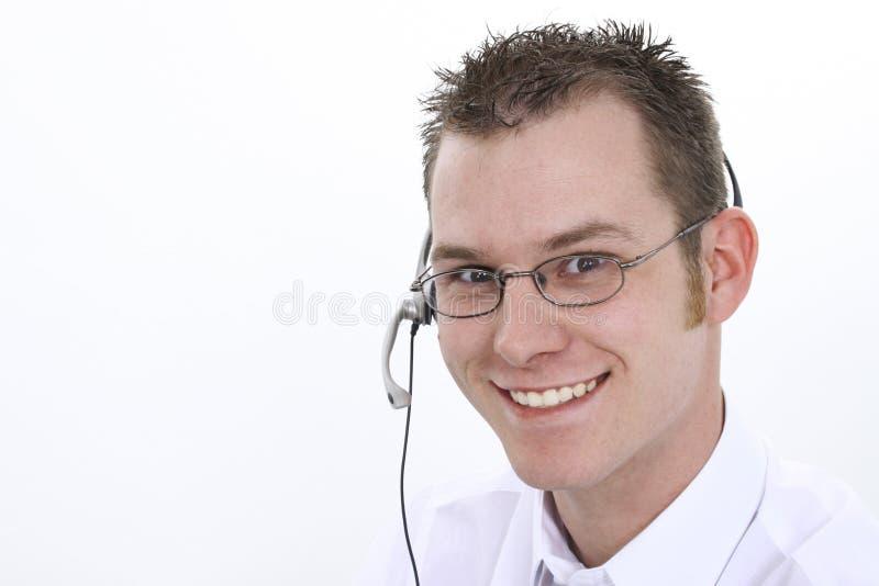 Representante do serviço de atenção a o cliente com sorriso foto de stock royalty free
