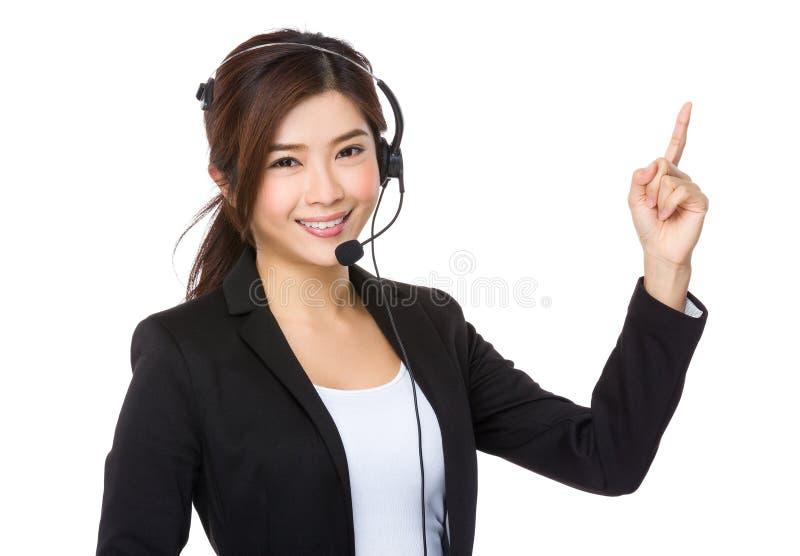 Representante e dedo de serviços ao cliente que apontam para cima foto de stock royalty free