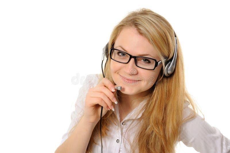 Representante femenino del servicio de atención al cliente en receptor de cabeza imagen de archivo
