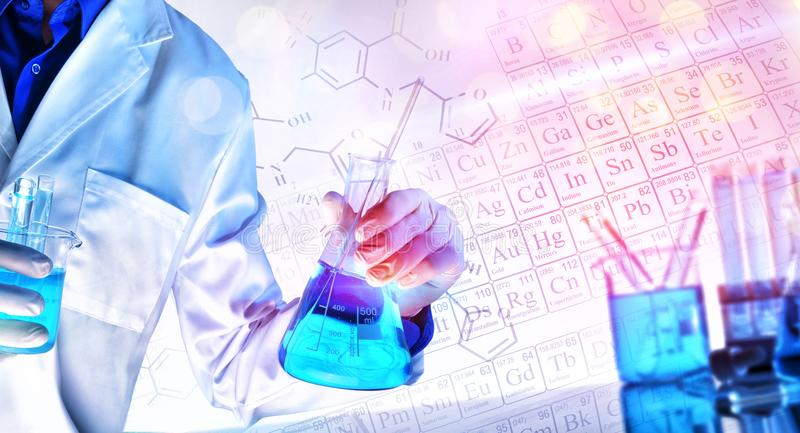 Representation of chemical sciences teaching concept with lights. Worker equipped with workwear and laboratory chemical material with representation of chemical royalty free stock image