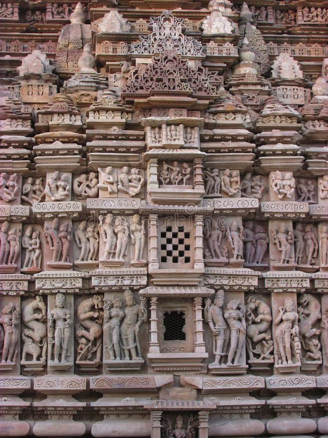 Details of Kama Sutra in temple, Khajuraho royalty free stock photography