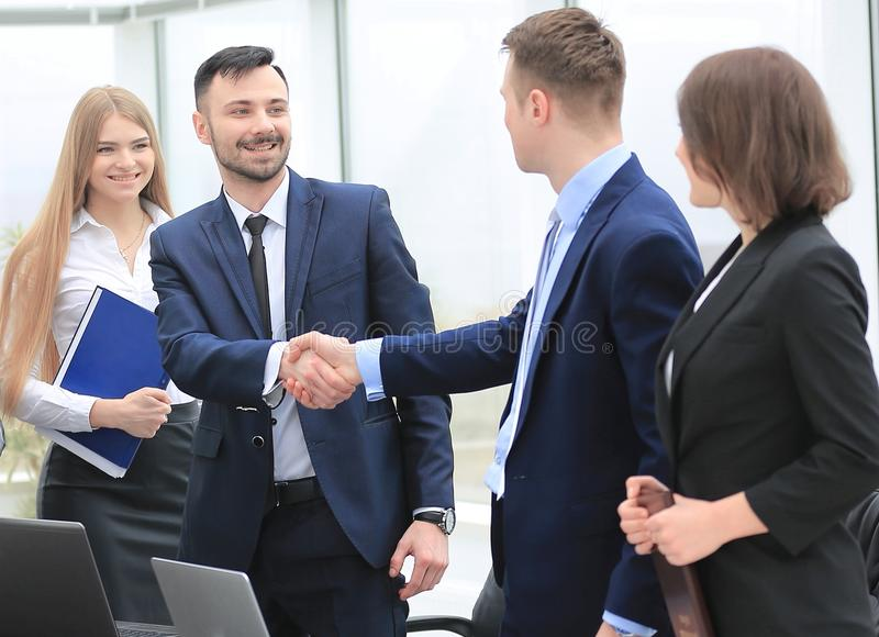 Representatives of the two business teams greet each other. Handshake between representatives of the two business teams royalty free stock images