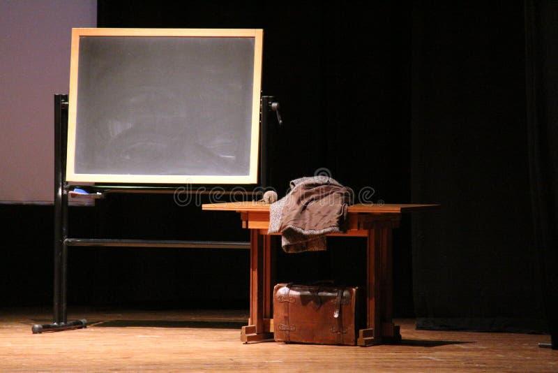 Reproducción de la escuela en el teatro imagen de archivo