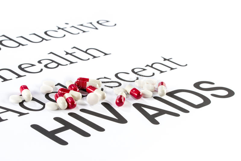 Reproductive health by Adolescent, AIDS, HIV, medication sicknes. Reproductive health by Adolescent, AIDS HIV, medication sickness capsule on paper stock image