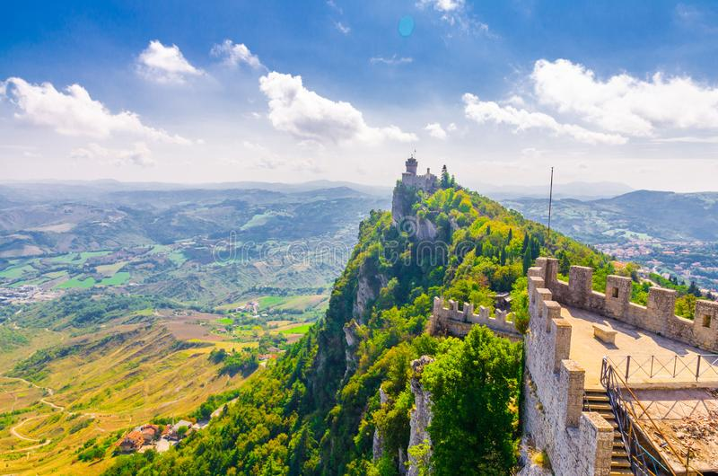Republic San Marino Seconda Torre La Cesta second fortress tower with brick walls on Mount Titano stone rock. Green trees, aerial top panoramic view of stock photo