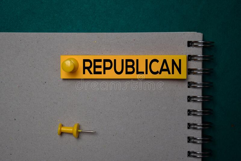 Republican write on a sticky note isolated on green background stock photos