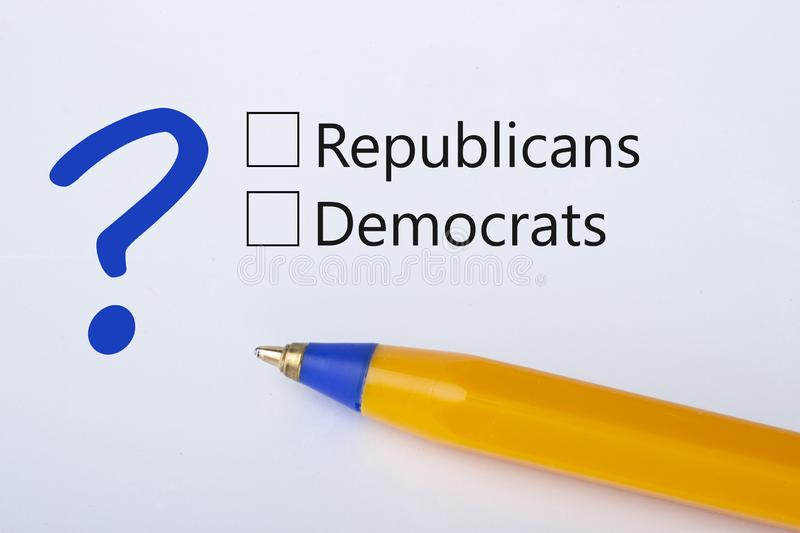 Republicans or Democrats - checkbox with a tick on white paper with yellow pen. Checklist concept royalty free stock photos