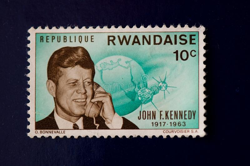 Republique Rwandaise stamp at 10 cents. Green John F Kennedy Republique Rwandaise stamp at 10 cents royalty free stock image