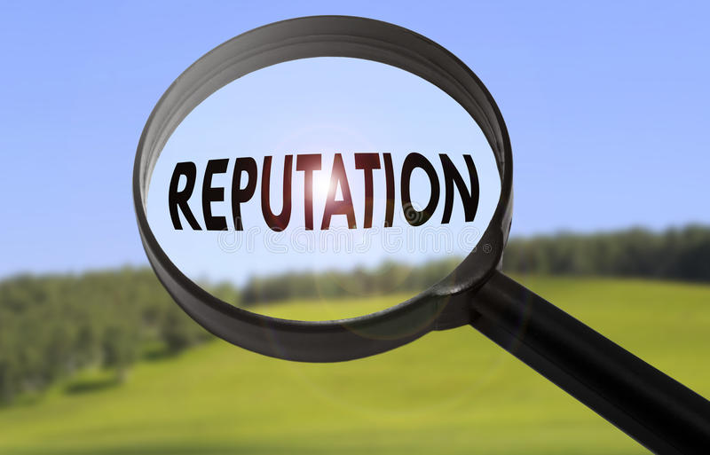 Reputation. Magnifying glass with the word reputation on blurred nature background. Searching reputation concept stock photos
