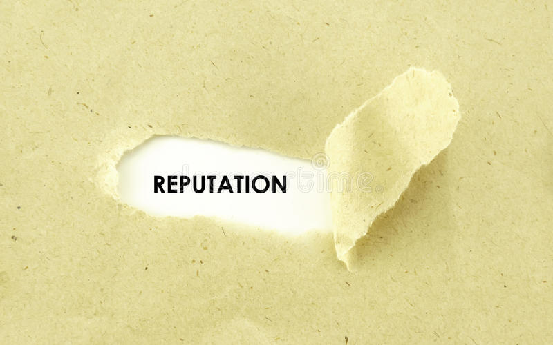 REPUTATION. Text REPUTATION appearing behind torn light brown envelope royalty free stock images
