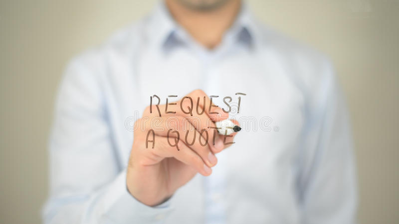 Request a Quote, man writing on transparent screen. High quality stock image