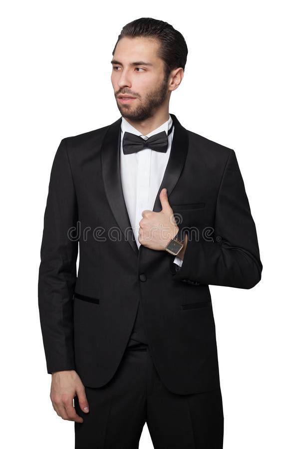 Requin de capitalisme Jeune apparence masculine d'homme d'affaires Il est habillé dans un costume noir strict riche images stock