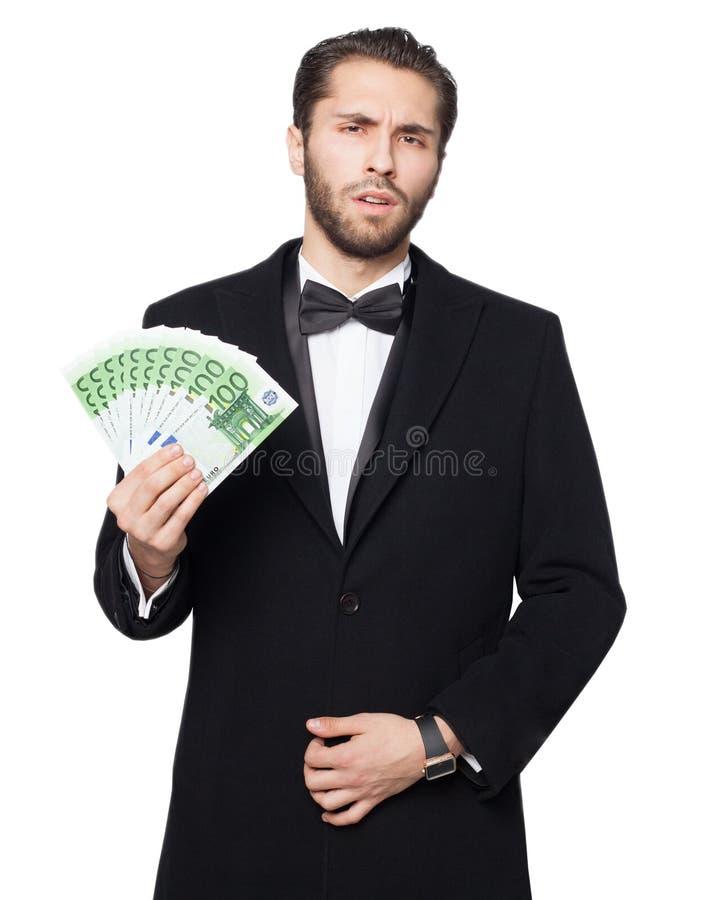 Requin de capitalisme Jeune d'affaires d'homme argent de représentation heureux cynique euro riche photos stock