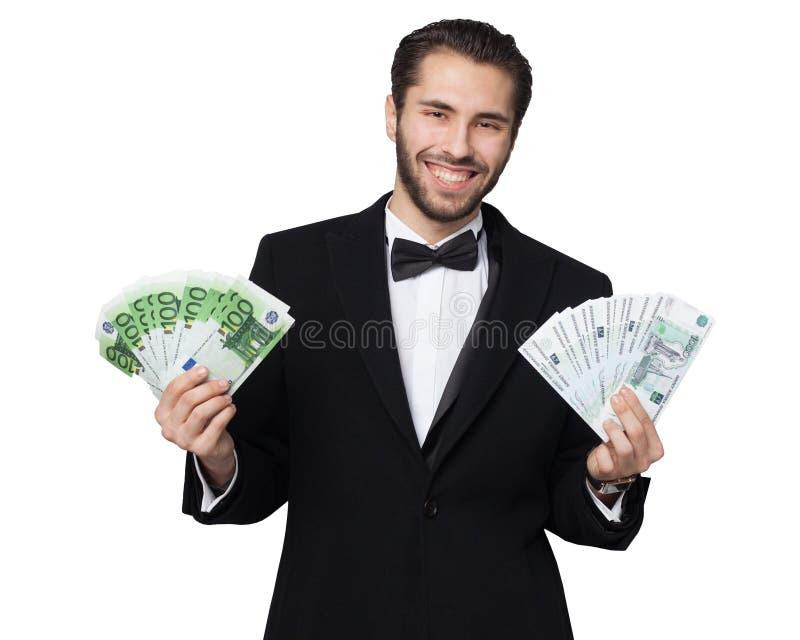 Requin de capitalisme Le jeune homme d'affaires masculin est heureux montrant l'argent, les roubles et les euros images libres de droits