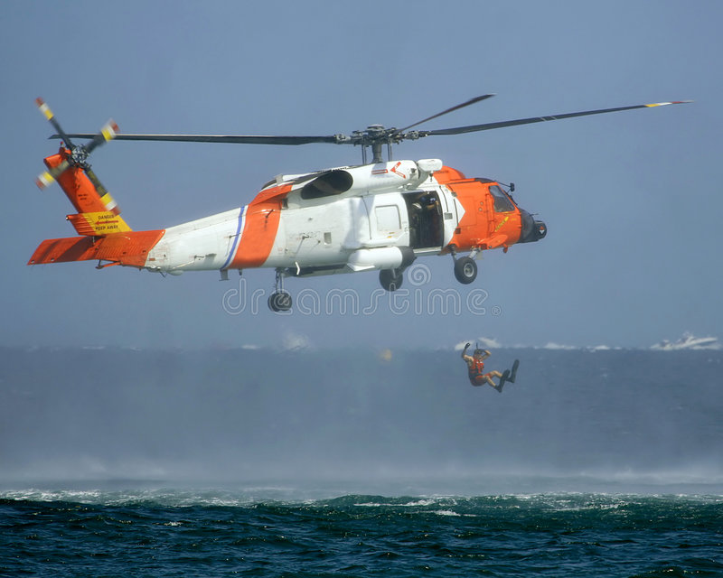 Rescate por helicóptero de U.S.C.G    foto de archivo