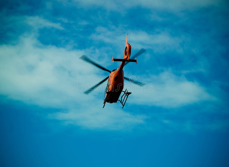 Rescue. A rescue helicopter against the blue sky stock images
