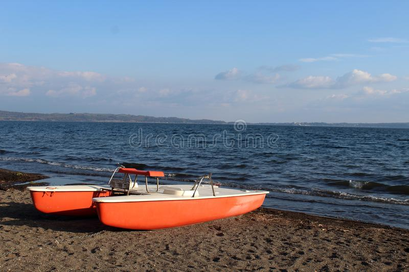 Rescue boat on the shore of a lake stock photography