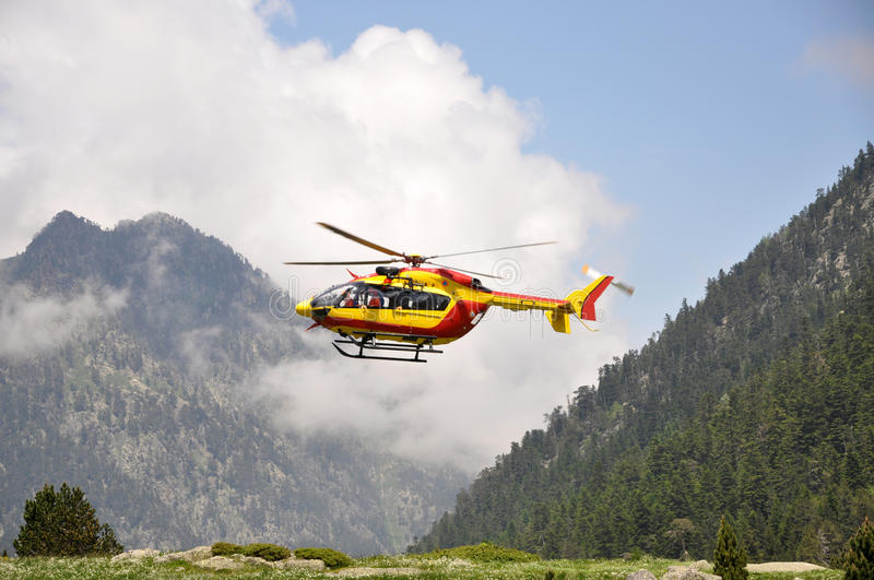 Rescue helicopter in the mountains stock images