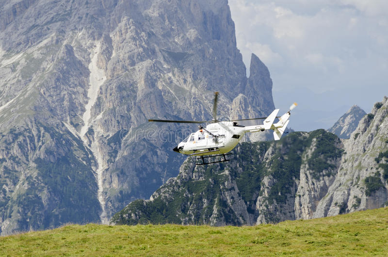 Rescue helicopter at the Three Peaks. Of Lavaredo, South Tyrol, Italy royalty free stock image