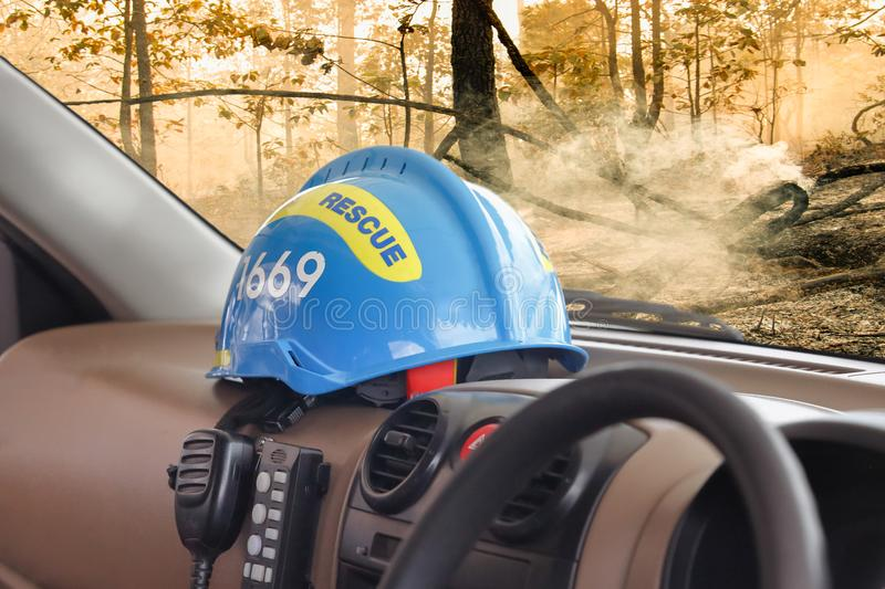 Rescue helmet put inside vehicle. At work stock photography