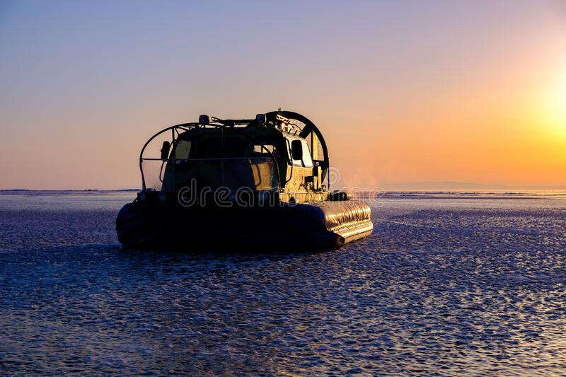 Rescue hovercraft on the ice in sunrise stock photography